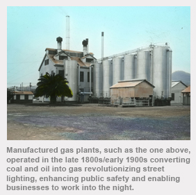 Manufactured gas plants, such as the one above, operated in the late 1800s/early 1900s converting coal and oil into gas revolutionizing street lighting, enhancing public safety and enabling businesses to work into the night.