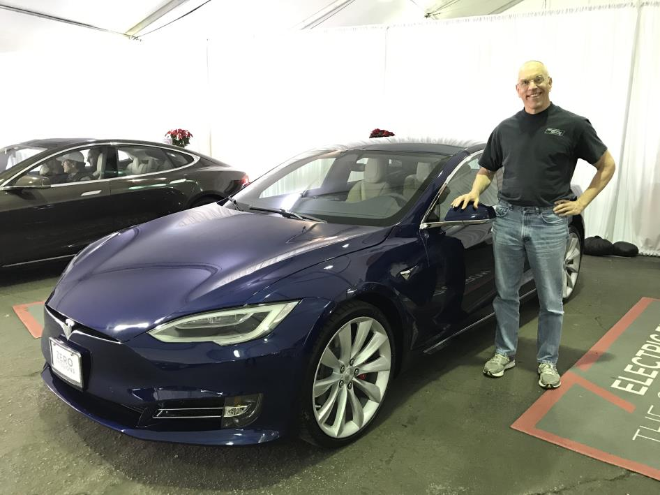 man with a tesla